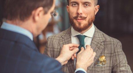 Moški pri krojaču