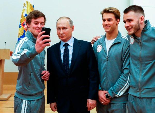 Putin z ruskimi športniki