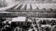 Začetki tovarne segajo v čas druge svetovne vojne – postavili so jo med aprilom 41' in junijem 42'. Za gradnjo prav na tem območju se Nemci sicer niso odločili po naključju.