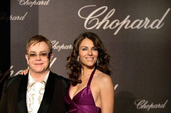 Elton John in Liz Hurley