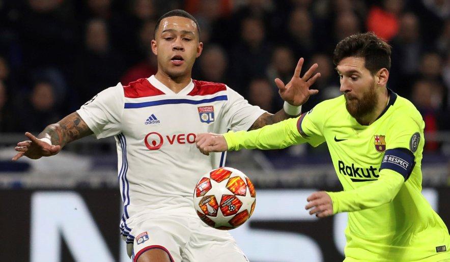 Memphis Depay in Lionel Messi
